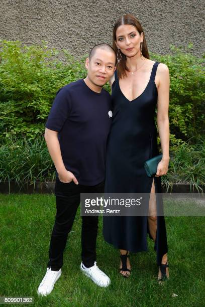 Jason Wu and Eva Padberg pose after the Hugo Boss presentation during 'Der Berliner Mode Salon' Spring/Summer 2018 at St Agnes Church on July 6 2017...