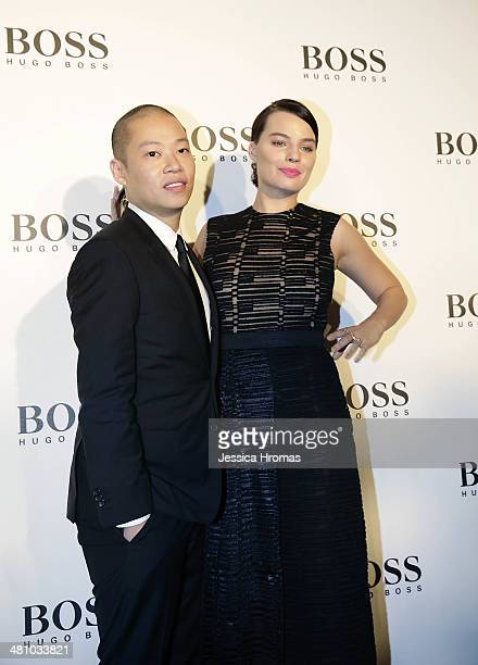 Jason Wu designer for Hugo Boss and Margot Robbie attend the opening of the Hugo Boss store on March 27 2014 in Central Hong Kong