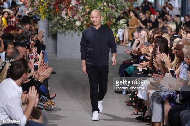 Jason Wu greets the audience after presenting the Jason Wu Spring 2018 collection during New York Fashion Week on September 8 2017 in New York City