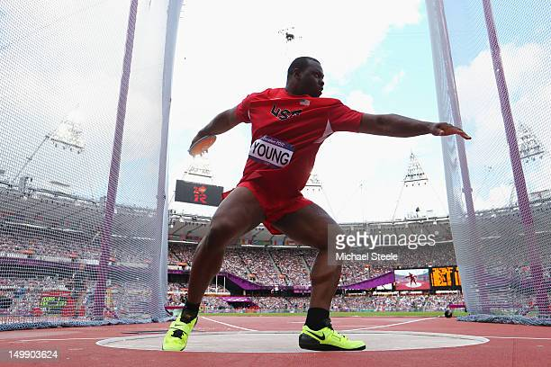 Jason Young of the United States competes in the Men's Discus Throw qualification on Day 10 of the London 2012 Olympic Games at the Olympic Stadium...