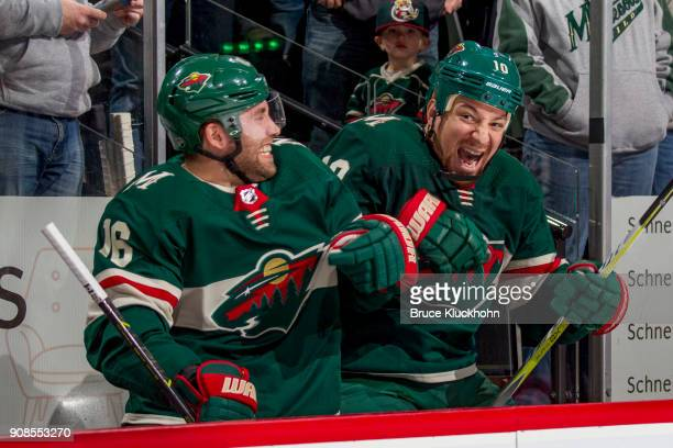Jason Zucker and Chris Stewart of the Minnesota Wild joke on the bench against the Winnipeg Jets during the game at the Xcel Energy Center on January...