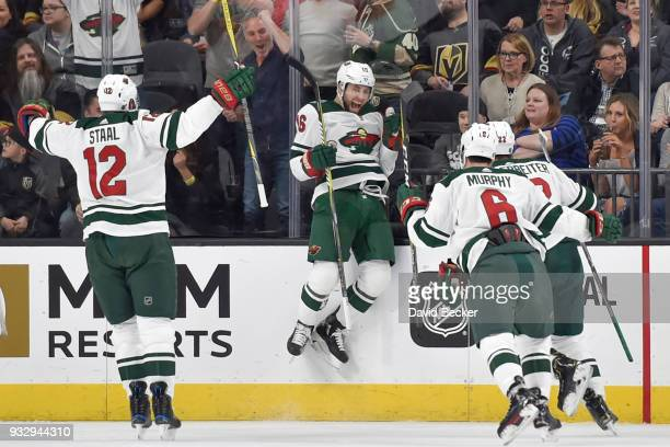 Jason Zucker celebrates his goal with teammates Eric Staal Ryan Murphy and Nino Niederreiter of the Minnesota Wild against the Vegas Golden Knights...