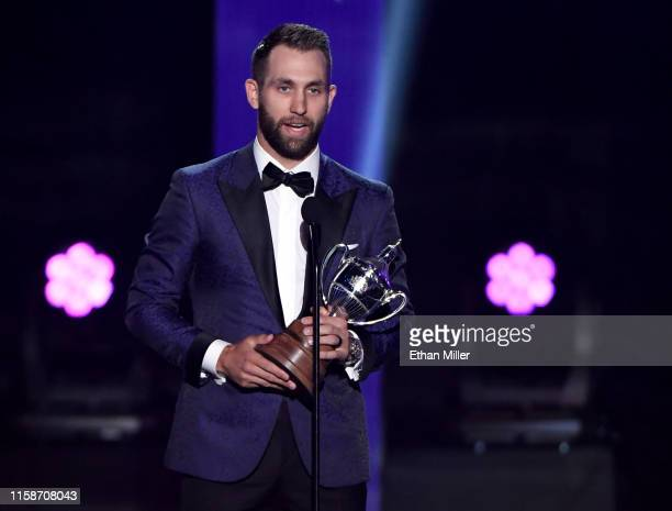 Jason Zucker of the Minnesota Wild accepts the King Clancy Memorial Trophy, given to player who best exemplifies leadership qualities on and off the...