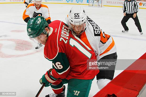 Jason Zucker of the Minnesota Wild and Nick Schultz of the Philadelphia Flyers battle for the puck along the boards during the game on January 7,...