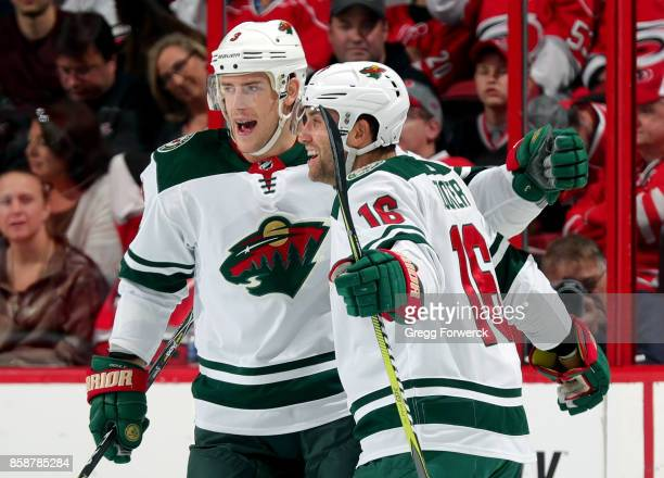 Jason Zucker of the Minnesota Wild celebrates his firstperiod goal against the Carolina Hurricanes with teammate Charlie Coyle during an NHL game on...