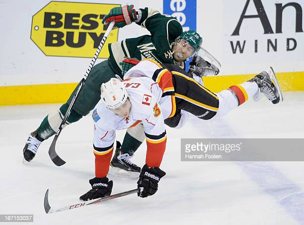 Jason Zucker of the Minnesota Wild collides with Brett Carson of the Calgary Flames during the third period of the game on April 21, 2013 at Xcel...