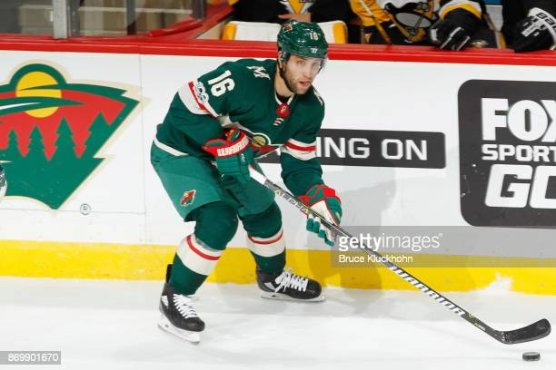 Jason Zucker of the Minnesota Wild handles the puck against the Pittsburgh Penguins during the game at the Xcel Energy Center on October 28 2017 in...