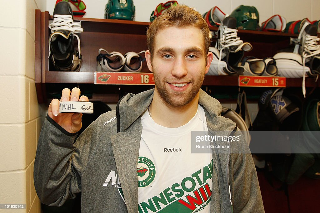 Jason Zucker #16 of the Minnesota Wild holds up the puck from his first career NHL goal scored against the Detroit Red Wings on February 17, 2013 at the Xcel Energy Center in Saint Paul, Minnesota.