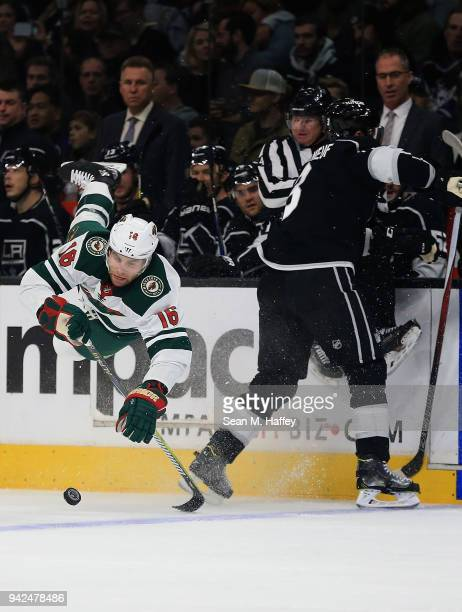 Jason Zucker of the Minnesota Wild is upended by Dion Phaneuf of the Los Angeles Kings during the first period at Staples Center on April 5, 2018 in...