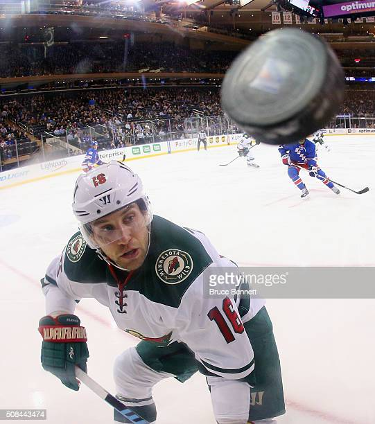 Jason Zucker of the Minnesota Wild keeps his eyes on the puck during the game against the New York Rangers at Madison Square Garden on February 4...
