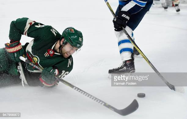 Jason Zucker of the Minnesota Wild looks on as Joe Morrow of the Winnipeg Jets takes the puck after Zucker fell to the ice second period in Game Four...