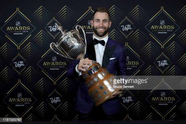 Jason Zucker of the Minnesota Wild poses with the King Clancy Memorial Trophy given to player who best exemplifies leadership qualities on and off...