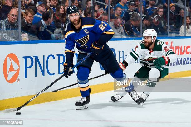 Jason Zucker of the Minnesota Wild pressures Alex Pietrangelo of the St. Louis Blues at Enterprise Center on October 30, 2019 in St. Louis, Missouri.