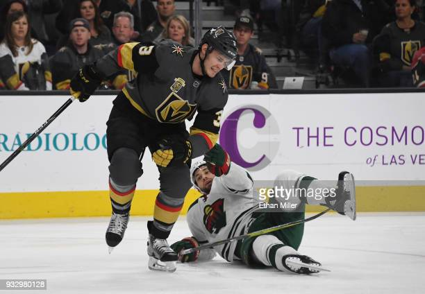 Jason Zucker of the Minnesota Wild pulls on Brayden McNabb of the Vegas Golden Knights in the first period of their game at TMobile Arena on March 16...