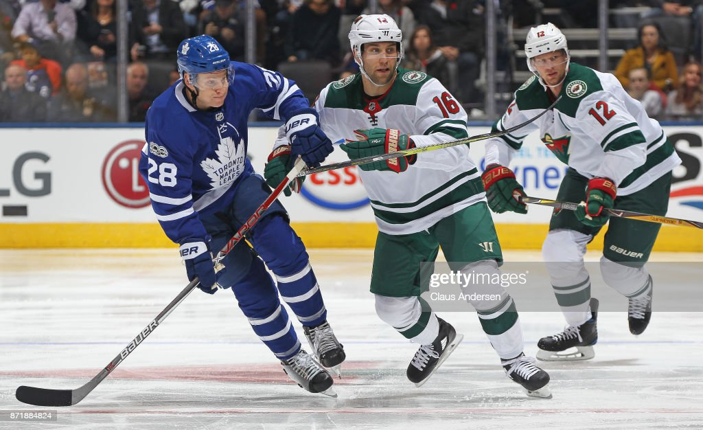Jason Zucker #16 of the Minnesota Wild skates against Connor Brown #28 of the Toronto Maple Leafs during an NHL game at the Air Canada Centre on November 8, 2017 in Toronto, Ontario, Canada. The Maple Leafs defeated the Wild 4-2.