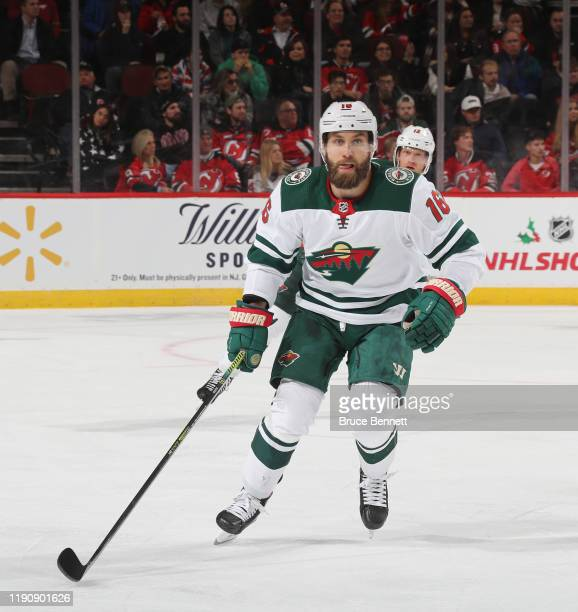 Jason Zucker of the Minnesota Wild skates against the New Jersey Devils at the Prudential Center on November 26, 2019 in Newark, New Jersey.