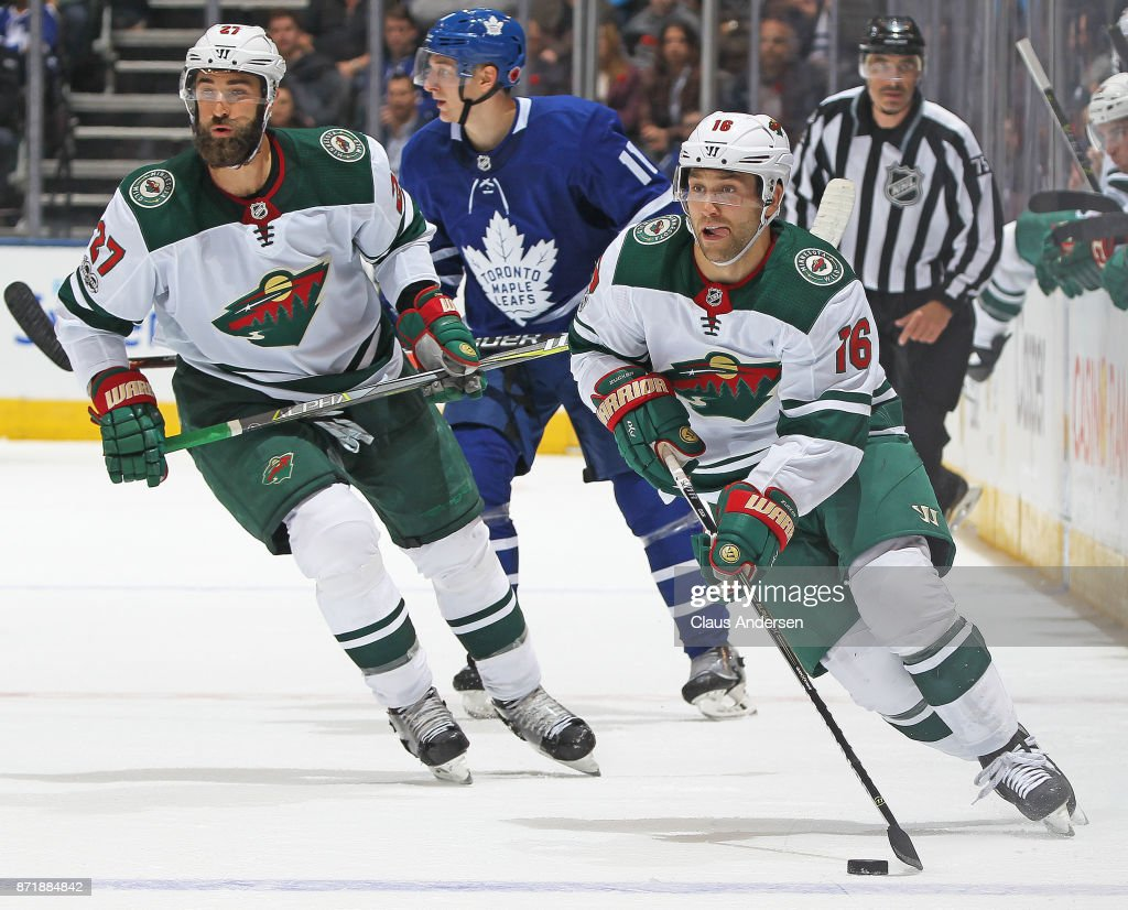 Jason Zucker #16 of the Minnesota Wild skates in for a shot against the Toronto Maple Leafs during an NHL game at the Air Canada Centre on November 8, 2017 in Toronto, Ontario, Canada. The Maple Leafs defeated the Wild 4-2.