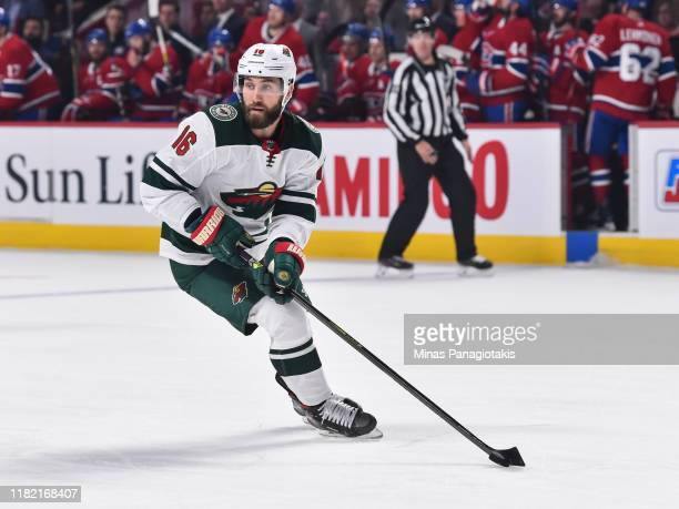 Jason Zucker of the Minnesota Wild skates the puck against the Montreal Canadiens during the second period at the Bell Centre on October 17, 2019 in...