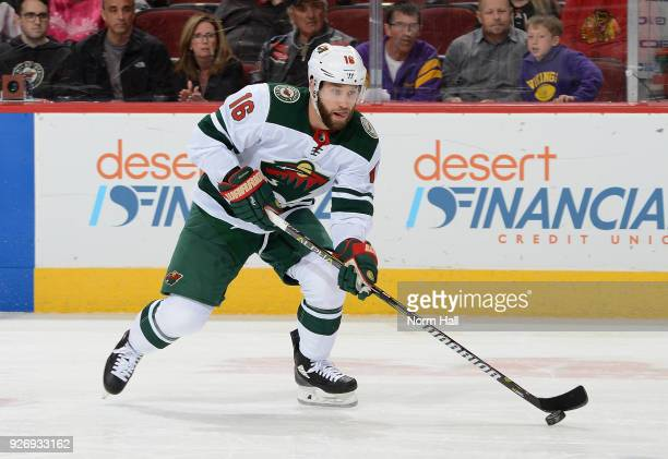 Jason Zucker of the Minnesota Wild skates the puck up ice against the Arizona Coyotes at Gila River Arena on March 1 2018 in Glendale Arizona
