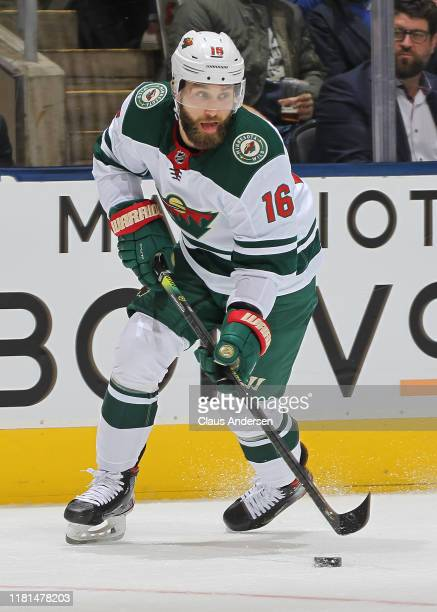 Jason Zucker of the Minnesota Wild skates with the puck against the Toronto Maple Leafs during an NHL game at Scotiabank Arena on October 15, 2019 in...