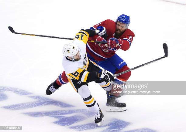Jason Zucker of the Pittsburgh Penguins and Shea Weber of the Montreal Canadiens collide in the first period in Game Four of the Eastern Conference...