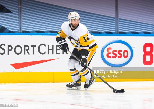 Jason Zucker of the Pittsburgh Penguins plays the puck against the Montreal Canadiens during the third period in Game Four of the Eastern Conference...