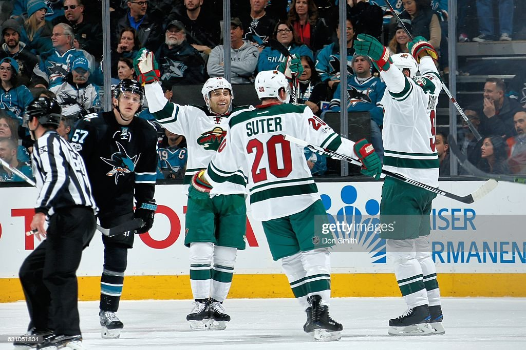 Jason Zucker #16, Ryan Suter #20 and Mikko Koivu #9 of the Minnesota Wild celebrate Koivu's second goal of the third period during a NHL game against the San Jose Sharks at SAP Center at San Jose on January 5, 2017 in San Jose, California.