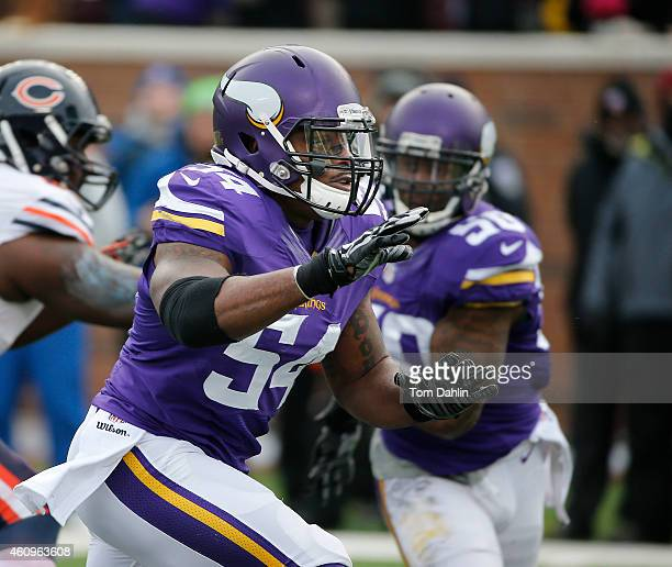 Jasper Brinkley of the Minnesota Vikings rushes the passer during an NFL game against the Chicago Bears at TCF Stadium on December 28 2014 in...