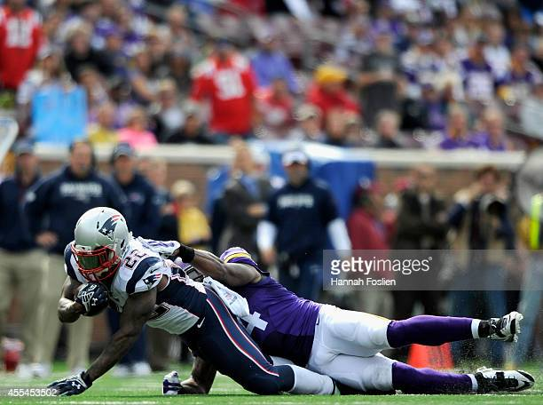 Jasper Brinkley of the Minnesota Vikings tackles Stevan Ridley of the New England Patriots during the fourth quarter of the game on September 14 2014...