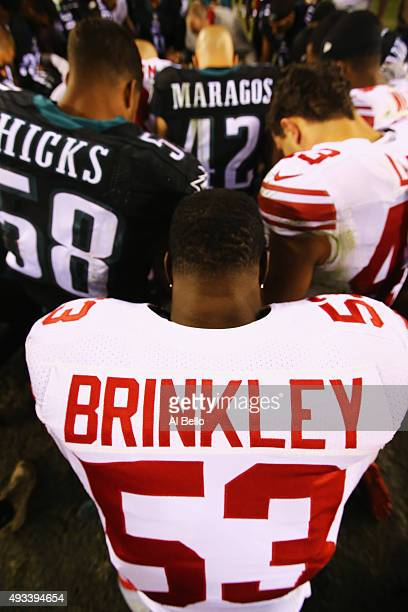 Jasper Brinkley of the New York Giants prays with the Philadelphia Eagles and New York Giants after their game at Lincoln Financial Field on October...