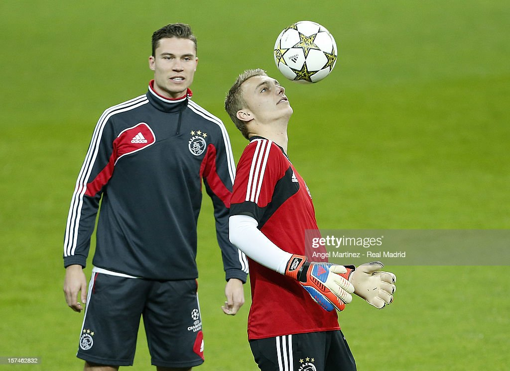 Jasper Cillessen (R) and Derk Boerrigter of AFC Ajax exercise during a training session ahead of their UEFA Champions League group stage match against Real Madrid at Estadio Santiago Bernabeu on December 3, 2012 in Madrid, Spain.