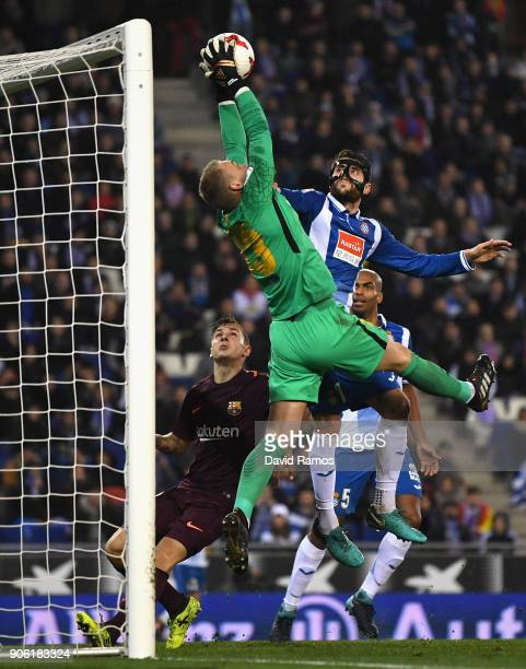 Jasper Cillessen of Barcelona catches the ball under pressure from David Lopez of Espanyol during the Spanish Copa del Rey Quarter Final First Leg...