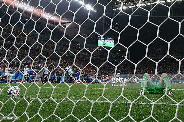 Jasper Cillessen of the Netherlands lies on the pitch after failing to save the penalty kick of Maxi Rodriguez of Argentina during the 2014 FIFA...