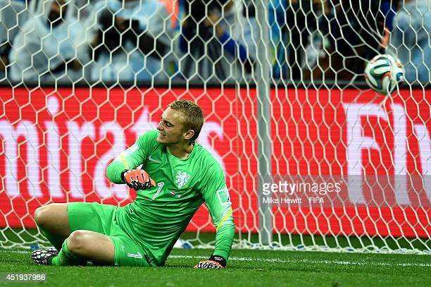 Jasper Cillessen of the Netherlands reacts after failing to stop the penalty kick by Lionel Messi of Argentina in the penalty shootout during the...