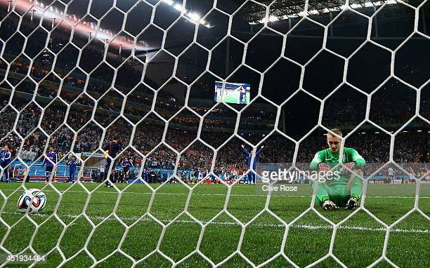 Jasper Cillessen of the Netherlands sits on the pitch after failing to save the penalty kick of Maxi Rodriguez of Argentina during the 2014 FIFA...