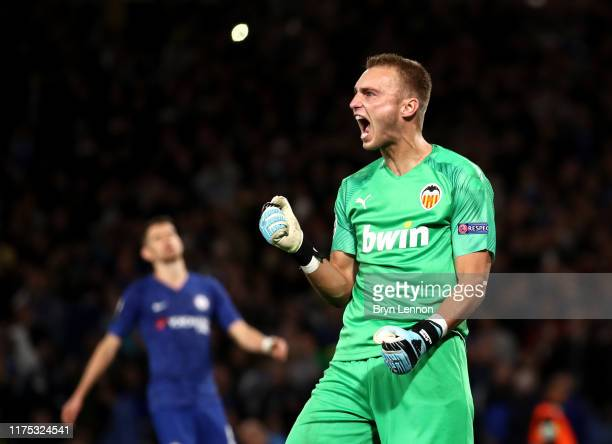 Jasper Cillessen of Valencia celebrates as Ross Barkley of Chelsea misses a penalty during the UEFA Champions League group H match between Chelsea FC...