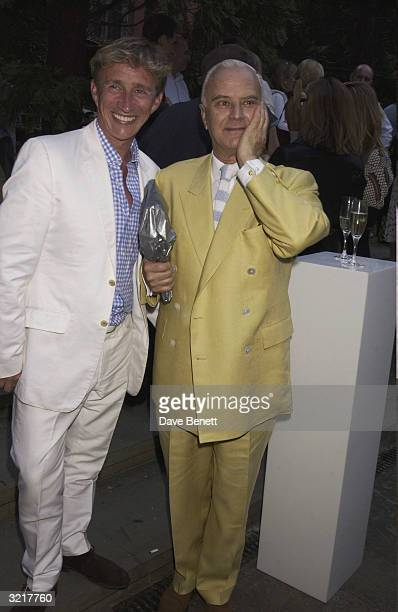 Jasper Conran and Manolo Blahnik attend the Ozzie Clark Retrospective at The Victoria and Albert Museum on July 15 2003 in London