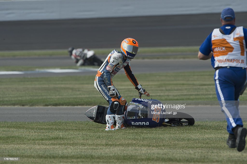 Jasper Iwema of Netherlands and RW Racing GP with marshall after crashed out during the Moto3 race during the MotoGp Red Bull U.S. Indianapolis Grand Prix - Race at Indianapolis Motor Speedway on August 18, 2013 in Indianapolis, Indiana.