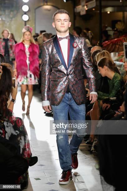 Jasper John Fielding Ford walks the Dolce Gabbana Italian Christmas catwalk show at Harrods on November 2 2017 in London England
