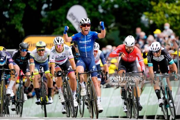 Jasper Philipsen of Belgium and Team Alpecin-Fenix, Mark Cavendish of The United Kingdom and Team Deceuninck - Quick-Step stage winner celebrates at...