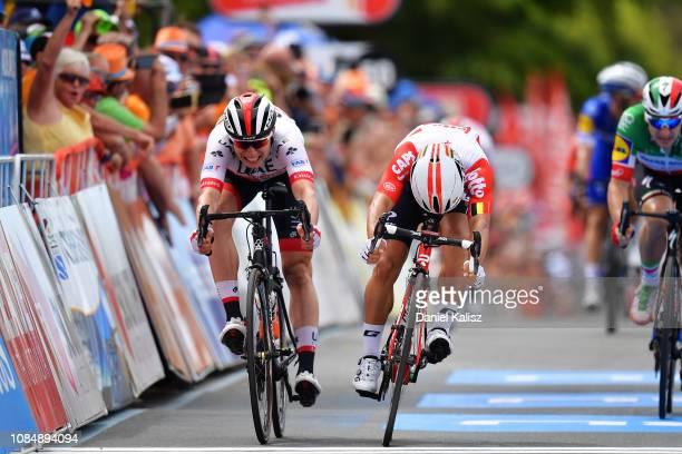 Jasper Philipsen of Belgium and UAE Team Emirates and Caleb Ewan of Australia and Team Lotto Soudal sprint to the line during the 21st Santos Tour...