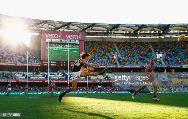 Jasper Pittard of the power kicks the ball during the round six AFL match between the Brisbane Lions and the Port Adelaide Power at The Gabba on...