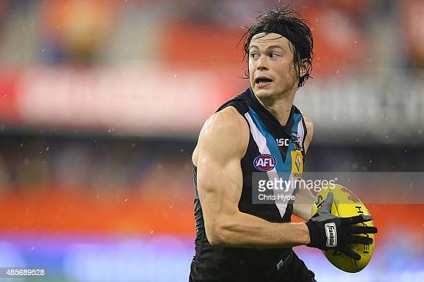 Jasper Pittard of the Power runs the ball during the round 22 AFL match between the Gold Coast Suns and the Port Adelaide Power at Metricon Stadium...