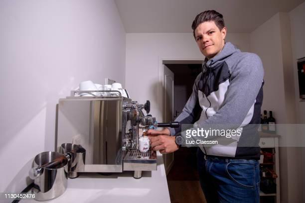 Jasper Stuyven of Belgium and Team Trek - Segafredo serves a coffee in his house on December 23, 2018 in Leuven, Belgium.