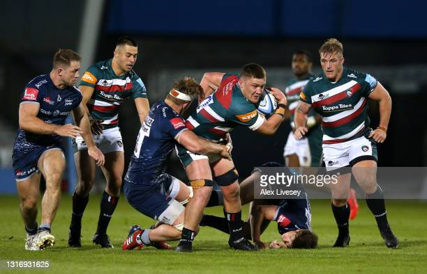 Jasper Wiese of Leicester powers his way through the challenge of Daniel du Preez and AJ MacGinty of Sale during the Gallagher Premiership Rugby...