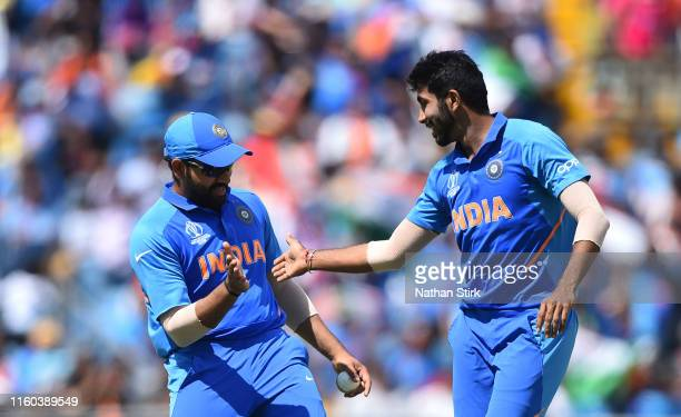 Jasprit Bumrah high fives Rohit Sharma of India after he gets Angelo Matthews of Sri Lanka out during the Group Stage match of the ICC Cricket World...
