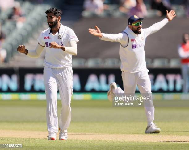 Jasprit Bumrah of India and Virat Kohli of India celebrate during day two of the First Test match between Australia and India at Adelaide Oval on...