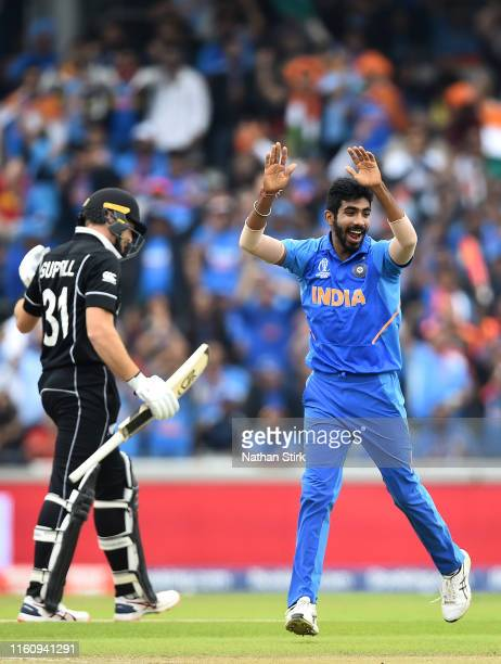 Jasprit Bumrah of India celebrates dismissing Martin Guptill of New Zealand during the Semi-Final match of the ICC Cricket World Cup 2019 between...