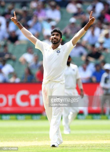 Jasprit Bumrah of India celebrates getting the wicket of Nathan Lyon of Australia during day three of the Third Test match in the series between...