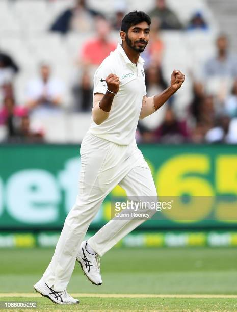 Jasprit Bumrah of India celebrates getting the wicket of Pat Cummins of Australia during a rain delay during day five of the Third Test match in the...